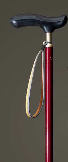 Image of   Elegant Spadserestok med Geléhåndtag og rødt Sildebensmønster